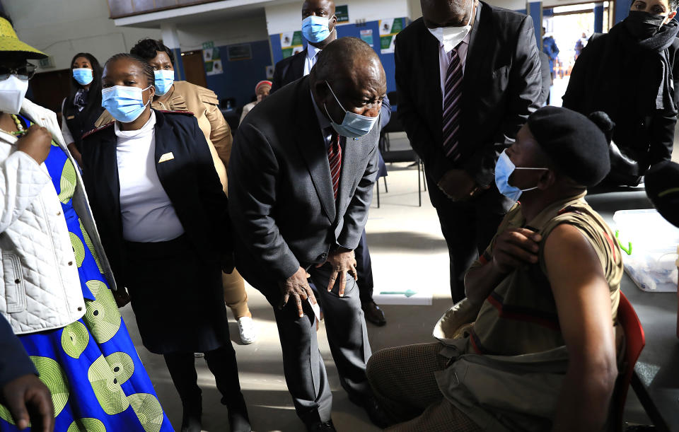 South African President Cyril Ramaphosa greets patients as he visits a COVID-19 vaccination centre in Tembisa, Thursday, July 29, 2021. Hitting its stride after a faltering start, South Africa's mass vaccination campaign gave jabs to 220,000 people a day last week and is accelerating toward the goal of 300,000 per day. With large deliveries of doses arriving and some vaccines being assembled here, South Africa appears on track to inoculate about 35 million of its 60 million people by the end of the year. (AP Photo)