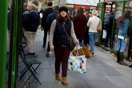 FILE PHOTO: A woman walks with shopping bags at Bryant Park in New York