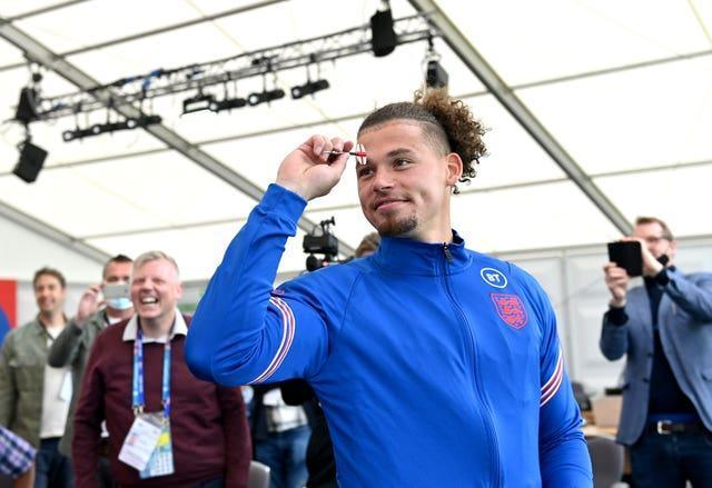 Kalvin Phillips plays darts with the media