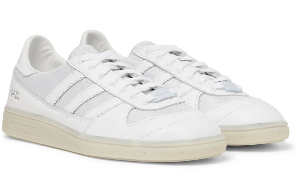 """<p><strong>adidas Consortium</strong></p><p>mrporter.com</p><p><strong>$150.00</strong></p><p><a href=""""https://go.redirectingat.com?id=74968X1596630&url=https%3A%2F%2Fwww.mrporter.com%2Fen-us%2Fmens%2Fproduct%2Fadidas-consortium%2Fshoes%2Flow-top-sneakers%2Fplus-new-order-spezial-wilsy-leather-and-reflective-mesh-sneakers%2F10516758727668993&sref=https%3A%2F%2Fwww.esquire.com%2Fstyle%2Fmens-fashion%2Fg35083025%2Fmr-porter-end-of-season-sale-2020%2F"""" rel=""""nofollow noopener"""" target=""""_blank"""" data-ylk=""""slk:Buy"""" class=""""link rapid-noclick-resp"""">Buy</a></p>"""
