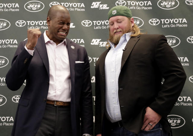 Former New York Jets offensive tackle D'Brickashaw Ferguson, left, pretends to cry as he talks to center Nick Mangold following a news conference making Mangold's official retirement from NFL football, Tuesday, April 24, 2018, in Florham Park, N.J. Mangold announced his retirement a week earlier in a post on Twitter. He was selected to seven Pro Bowls and was twice a first-team All-Pro during his 11-year career. (AP Photo/Julio Cortez)