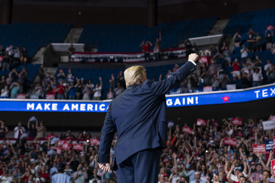 <p>President Donald Trump arrives on stage to speak at a campaign rally at the BOK Center, Saturday, June 20, 2020, in Tulsa, Okla. (AP Photo/Evan Vucci)</p>