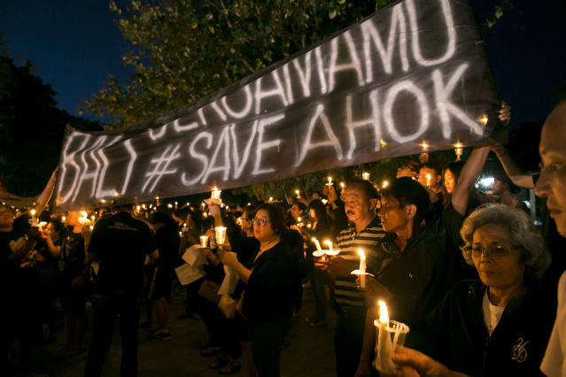 <p>Supporters of Jakarta's former governor Basuki Tjahaja Purnama, popularly known as 'Ahok', gather to show their support in Denpasar, Bali, Indonesia, May 11, 2017. Hundreds of Ahok supporters gathered and lit candles to express their support and demand the releaser of Basuki Tjahaja Purnama. An Indonesian court had sentenced him to two years in jail for blasphemy. (Photo: Made Nagi/EPA) </p>