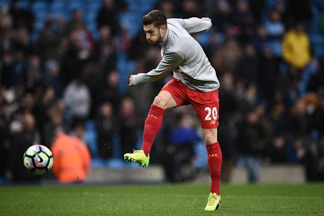 Liverpool's midfielder Adam Lallana warms up ahead of the English Premier League football match against Manchester City March 19, 2017 (AFP Photo/Oli SCARFF)