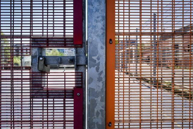 A padlock and bolt secure the mesh fencing to a five-a-side pitch in Bristol to prevent access as the UK continues in lockdown to help curb the spread of the coronavirus