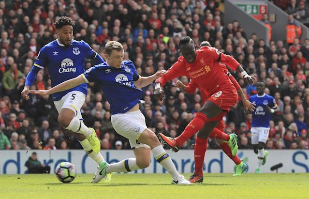 <p>Liverpool's Sadio Mane, right, scores his side's first goal, during the English Premier League soccer match between Liverpool and Everton, at Anfield, in Liverpool </p>