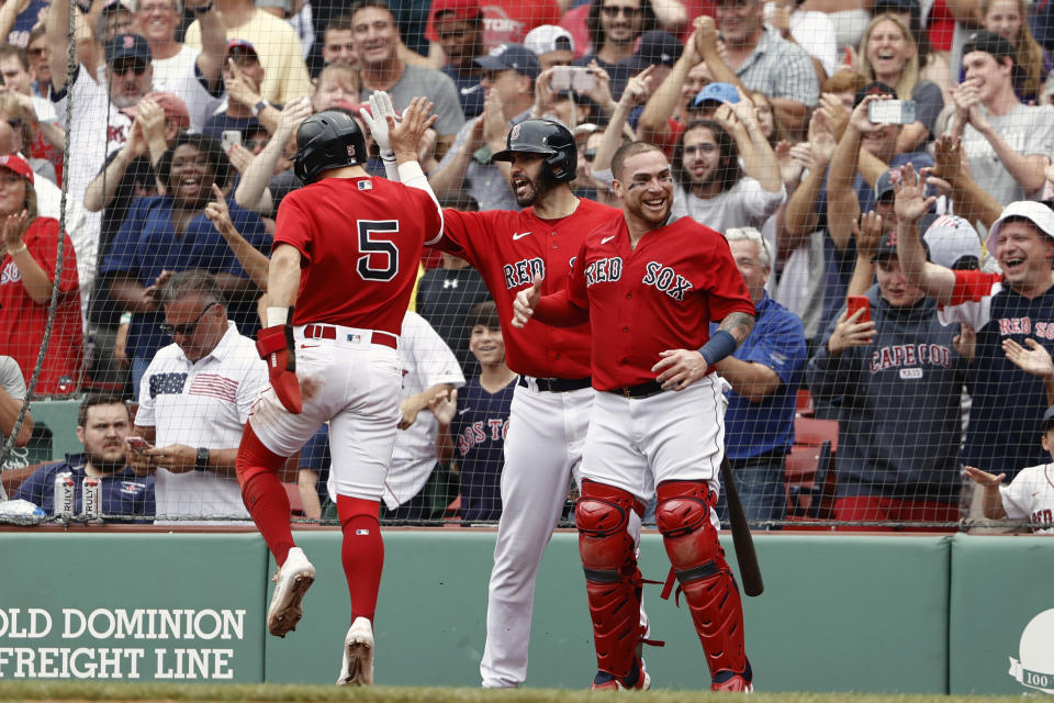 Enrique Hernandez (5) of the Boston Red Sox celebrates with J.D. Martinez, center, and catcher Christian Vazquez after scoring the go-ahead run against the Yankees on Sunday. (Photo By Winslow Townson/Getty Images)
