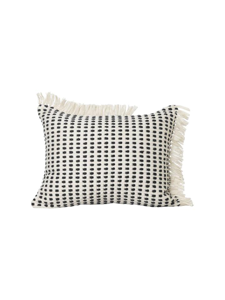 """<p>This stunning monochrome cushion has been made from 55 plastic bottles. Framed by asymmetric white fringe, it is sure to add a stylish touch to your home, while also helping the environment.</p><p><a class=""""body-btn-link"""" href=""""https://go.redirectingat.com?id=127X1599956&url=https%3A%2F%2Fwww.heals.com%2Fway-outdoor-cushion-50-x-70cm.html&sref=https%3A%2F%2Fwww.housebeautiful.com%2Fuk%2Flifestyle%2Fshopping%2Fg30366588%2Fheals-furniture-sustainable-collection%2F"""" target=""""_blank"""">BUY NOW, £85</a></p>"""
