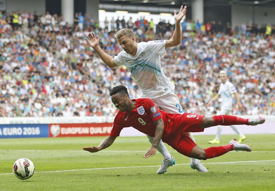 FILE - In this Sunday, June 14, 2015 file photo, England's Raheem Sterling, bottom, is challenged by Slovenia's Ales Mertelj during the Euro 2016 Group E qualifying soccer match between Slovenia and England, in Ljubljana, Slovenia. A person familiar with the situation says Liverpool has reached an agreement with Manchester City over the transfer of England winger Raheem Sterling for 49 million pounds ($76 million). (AP Photo/Darko Bandic, File)