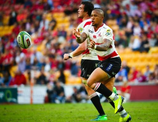 The Golden Lions' Elton Jantjies passes the ball during their Super Rugby match against the Queensland Reds, in Brisbane, on April 28, 2018