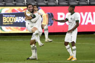 Portland Timbers defender Jorge Villafaña, left to right, celebrates his game-tying goal with Diego Valeri and Andy Polo during the second half of an MLS soccer match against Los Angeles FC in Los Angeles, Sunday, Nov. 8, 2020. The game ended in a 1-1 draw. (AP Photo/Kelvin Kuo)