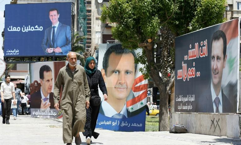 Posters promoting Assad have been plastered across areas of Syria controlled by the government