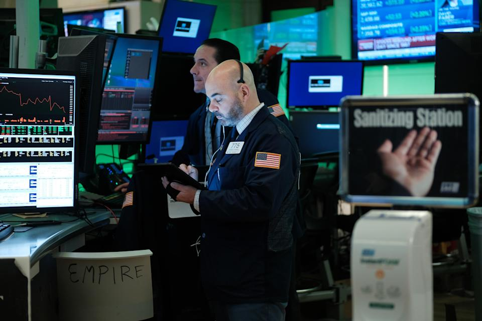 NEW YORK, NEW YORK - MARCH 17: Traders work on the floor of the New York Stock Exchange (NYSE) on March 17, 2020 in New York City. The Dow was up slightly in morning trading following a day that saw one of the worst drops in the market's history as America and the world react to the spreading of the coronavirus. (Photo by Spencer Platt/Getty Images)