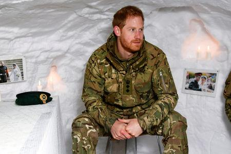 Britain's Prince Harry, Captain General Royal Marines, sits in a snow cave decorated with candles and his wedding photos, during Exercise Clockwork, celebrating 50 years of cold weather military training at Bardufoss Air Station, Norway February 14, 2019. NTB Scanpix/Rune Stoltz Bertinussen via REUTERS