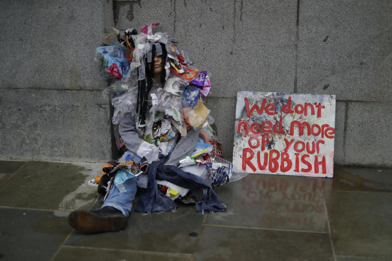 A climate protestors sits outside Britain's Parliament in central London, Oct. 7, 2019. (Photo: Matt Dunham/AP)
