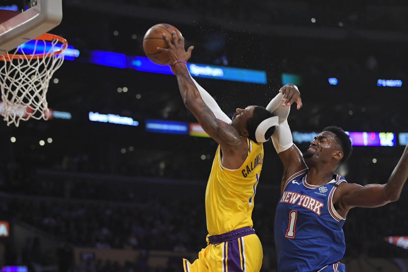 New York Knicks forward Bobby Portis, right, fouls Los Angeles Lakers guard Kentavious Caldwell-Pope during the first half of an NBA basketball game Tuesday, Jan. 7, 2020, in Los Angeles. Portis was ejected from the game after the foul. (AP Photo/Mark J. Terrill)