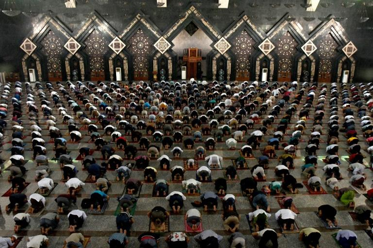 Mosque-goers were also ordered to bring their own prayer mats and abide by social-distancing rules with temperature checks at the door (AFP Photo/DASRIL ROSZANDI)
