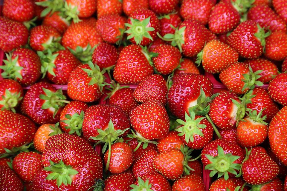 """<p>Strawberries might seem like a summer fruit, but they actually start to come into season in spring/early summer, which is when they're particularly sweet and juicy. """"Strawberries provide fiber, vitamins A, C and E, and are loaded with antioxidants that we know helps us fight off disease,"""" says Lynell Ross, certified health and wellness coach, nutritionist, and founder of <a href=""""https://www.zivadream.com/"""" rel=""""nofollow noopener"""" target=""""_blank"""" data-ylk=""""slk:Zivadream"""" class=""""link rapid-noclick-resp"""">Zivadream</a>. She added that vitamin A can support bone health, while vitamin C can boost our immune systems and also promote growth and development of body tissue, bone, and teeth.<br></p>"""
