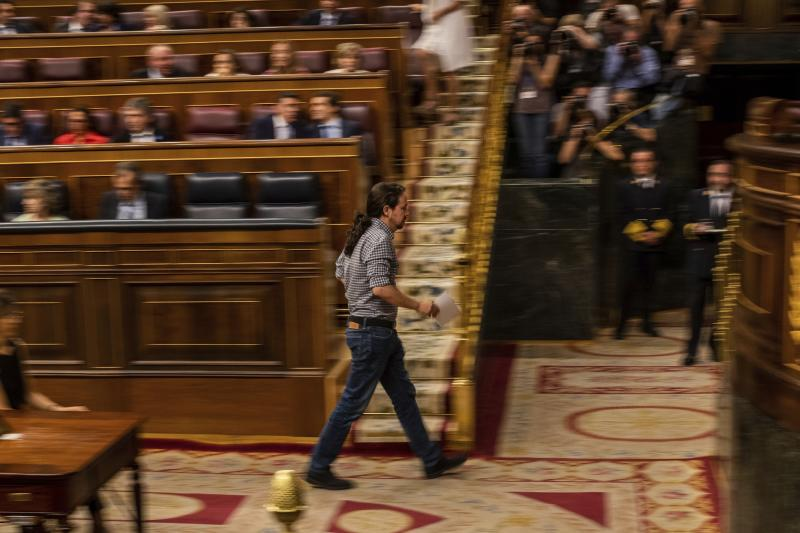 United Podemos (United We Can) party leader Pablo Iglesias walks during the parliamentary debate at the Spanish parliament in Madrid, Spain, Monday, July 22, 2019. Spain's caretaker Prime Minister Pedro Sánchez will seek the endorsement of the Spanish Parliament on Monday ahead of this week's confidence votes for him to form a new government. (AP Photo/Bernat Armangue)
