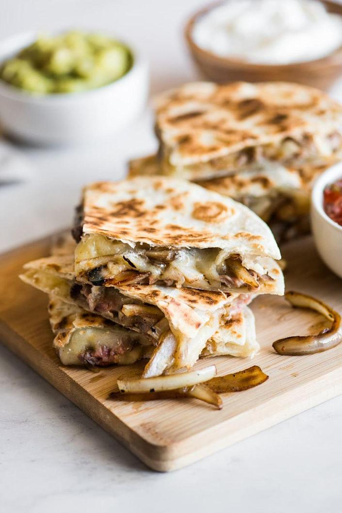"""<p>Flank steak and skirt steak are the best cuts of beef for these quesadillas, primarily because they're inexpensive and easy to cook ahead. Just be sure to slice them as thinly as possible. </p><p><strong>Get the recipe at <a href=""""https://www.isabeleats.com/steak-quesadillas/"""" rel=""""nofollow noopener"""" target=""""_blank"""" data-ylk=""""slk:Isabel Eats"""" class=""""link rapid-noclick-resp"""">Isabel Eats</a>.</strong></p>"""