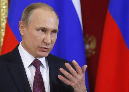 FILE PHOTO: Russian President Putin speaks during a news conference in Moscow