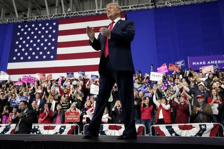 U.S. President Donald Trump waves as he arrives to speak in support of Republican congressional candidate Rick Sacconne during a Make America Great Again rally in Moon Township Pennsylvania U.S
