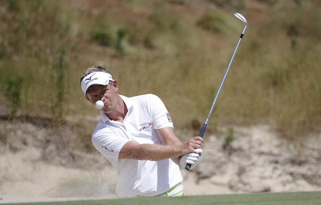 Luke Donald, of England, hits out of the bunker on the 16th hole during a practice round for the U.S. Open golf tournament in Pinehurst, N.C., Wednesday, June 11, 2014. The tournament starts Thursday. (AP Photo/Matt York)