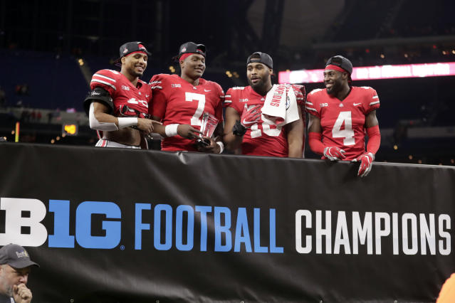 Ohio State's Keandre Jones, Dwayne Haskins, Jonathon Cooper and Jordan Fuller, from left, celebrate after defeating Northwestern 45-24 in the Big Ten title game. (AP Photo/Michael Conroy)