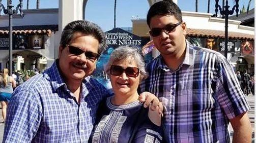 From left to right: Russell French, Paola French and their son, Kenneth French, at Universal Studios. Kenneth, 32, was shot and killed by an off-duty police officer in a Corona Costco on June 14. (Courtesy of family)