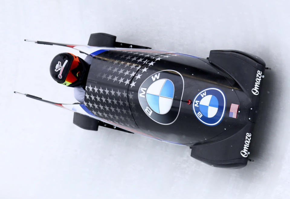 United State's bobsleigh pilot Kaillie Humphries speeds down the track during the women's monobob race at the Bobsleigh and Skeleton World Championships in Altenberg, Germany, Saturday, Feb.13, 2021. (AP Photo/Matthias Schrader)