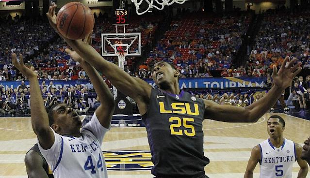 LSU forward Jordan Mickey (25) works against Kentucky center Dakari Johnson (44) during the first half of an NCAA college basketball game in the quarterfinal round of the Southeastern Conference men's tournament, Friday, March 14, 2014, in Atlanta. (AP Photo/John Bazemore)