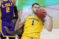 Michigan center Hunter Dickinson (1) grabs a rebound over LSU forward Darius Days, left, during the second half of a second-round game in the NCAA men's college basketball tournament at Lucas Oil Stadium Monday, March 22, 2021, in Indianapolis. (AP Photo/AJ Mast)
