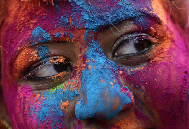 <p>The face of a woman is smeared with colored powder during Holi, the Hindu festival of colors in Kolkata, India, Thursday, March 1, 2018. (Photo: Bikas Das/AP) </p>