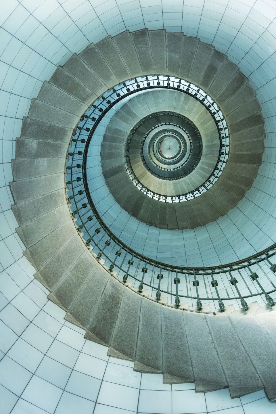 <p>This perfect spiral is found off the coast of Brittany, and it is the tallest traditional lighthouse in the world. To see these beautiful blue walls in person you'd have to climb up 375 steps. </p>