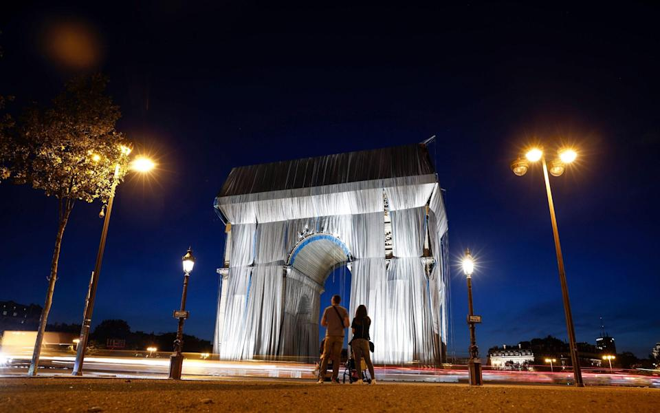 Arc De Triomphe in Paris is covered in silver-blue fabric as a tribute to thelate artist Christo - YOAN VALAT/EPA-EFE/Shutterstock