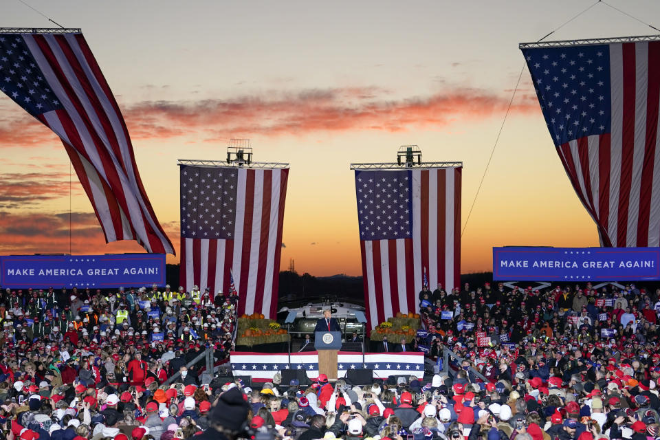 President Donald Trump addresses the crowd as the sun sets during a campaign stop, Saturday, Oct. 31, 2020, at the Butler County Regional Airport in Butler, Pa. (AP Photo/Keith Srakocic)
