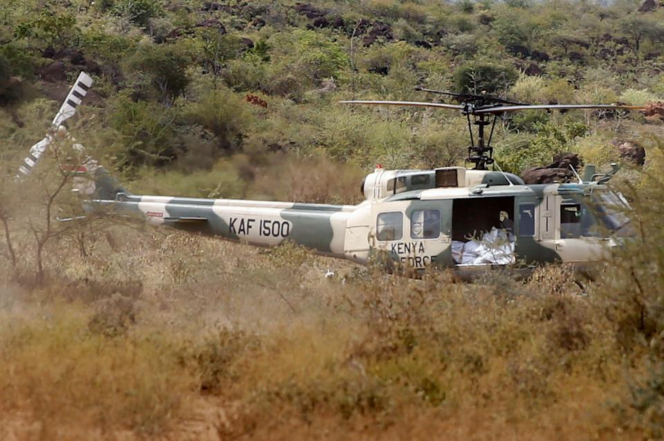 A Kenya Air Force rescue helicopter is seen near the scene where the Kenya Air Force Mi 171 E helicopter crashed in the county of Kajiado, Kenya June 24, 2021. REUTERS/Stringer