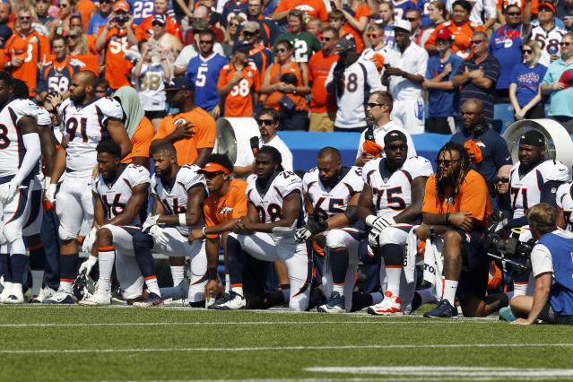 <p>Denver Bronco players kneel in protest during the National Anthem before a game against the Buffalo Bills at New Era Field. Mandatory Credit: Timothy T. Ludwig-USA TODAY Sports </p>