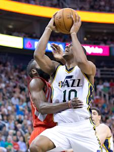 Jazz guard Alec Burks goes to the bucket against Rockets guard James Harden on Wednesday night. (USA TODAY Sports)
