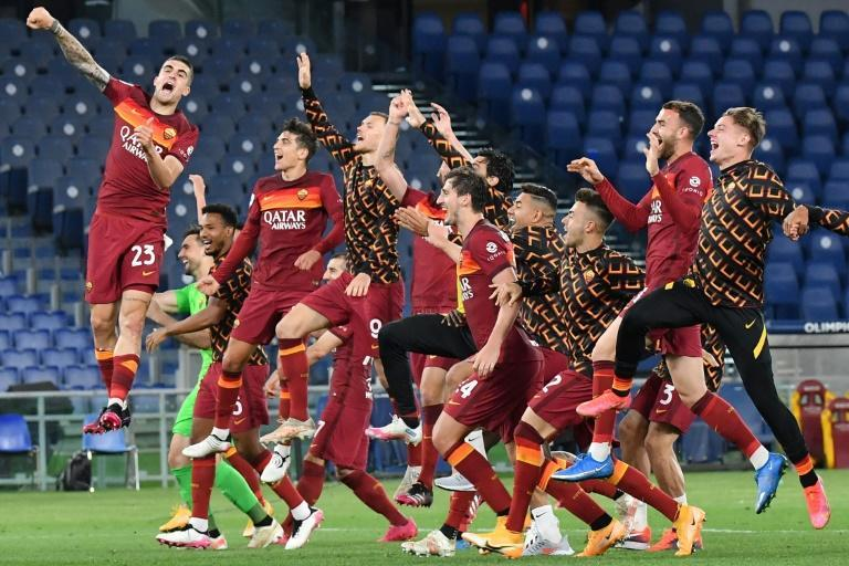 Roma players celebrate derby win.