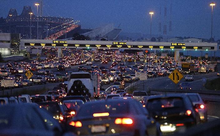 In this file photo from Monday, July 1, 2013, commuters wait in standstill traffic to pay their tolls on the San Francisco-Oakland Bay Bridge in Oakland, Calif. A major San Francisco Bay Area transit system ran trains as usual on Friday after labor negotiations were extended past a midnight deadline, but the threat of a commute-disrupting strike loomed with the unions promising to walk off the job Monday if weekend talks fail to reach a deal. (AP Photo/Ben Margot)