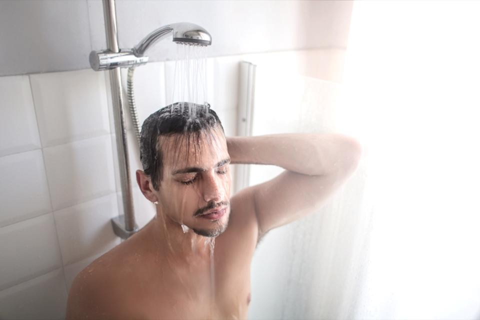 Man warming up in the shower
