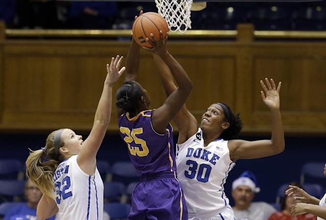 Duke's Tricia Liston (32) and Amber Henson (30) defend against Albany's Shereesha Richards (25) during the first half of an NCAA college basketball game in Durham, N.C., Thursday, Dec. 19, 2013. (AP Photo/Gerry Broome)