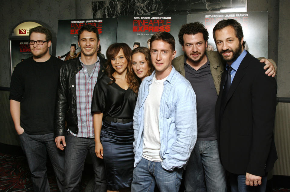 Pictured from left to right, Seth Rogen, James Franco, Rosie Perez, Shauna Robertson, David Gordon Green, Danny McBride, and Judd Apatow, attend a special screening, hosted by Three Olives, of the film Pineapple Express in New York, Tuesday, Aug., 5, 2008. (AP Photo/Stuart Ramson)