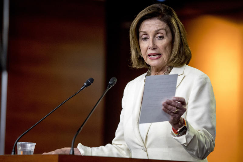 """House Speaker Nancy Pelosi of Calif. reads from a paper titled """"Know Your Rights"""" regarding ICE agents attempting to perform raids as she meets with reporters on Capitol Hill in Washington, Thursday, July 11, 2019. (AP Photo/Andrew Harnik)"""