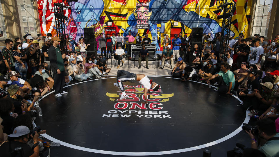 B-boys Jiggz, center, and Flow.T compete during Red Bull BC One event on, Saturday, July 24, 2021. in New York. Many in the breaking community are eager for the art form to expand its audience after the International Olympic Committee announced that it would become an official sport at the Paris 2024 games. But that optimism is hardly unanimous. (AP Photo/Eduardo Munoz Alvarez)