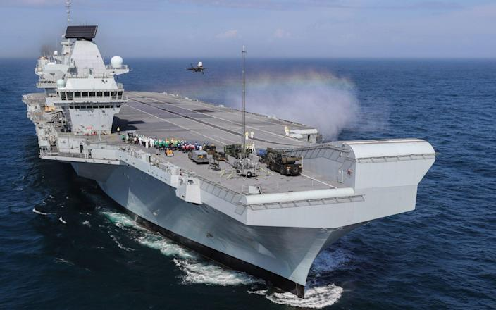 HMS Queen Elizabeth begins its maiden deployment to the Indo-Pacific region this month - PA