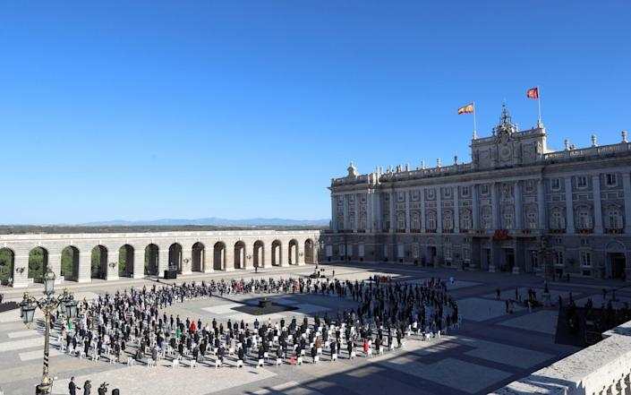 A general view of Plaza de la Armeria courtyard at the Royal Palace during the socially distanced state tribute - Shutterstock