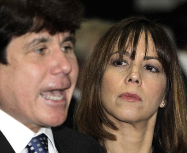 FILE - In this June 8, 2010, file photo, Patti Blagojevich, wife of former Illinois Gov. Rod Blagojevich, listens to her husband as they arrive at the federal courthouse for his corruption trial in Chicago. Patti Blagojevich made repeated public pleas for her husband's release from federal prison. Her campaign began in 2018 soon after her husband lost a string of legal appeals that seemed to doom him to remain behind bars until his projected 2024 release date. (AP Photo/Charles Rex Arbogast, File)