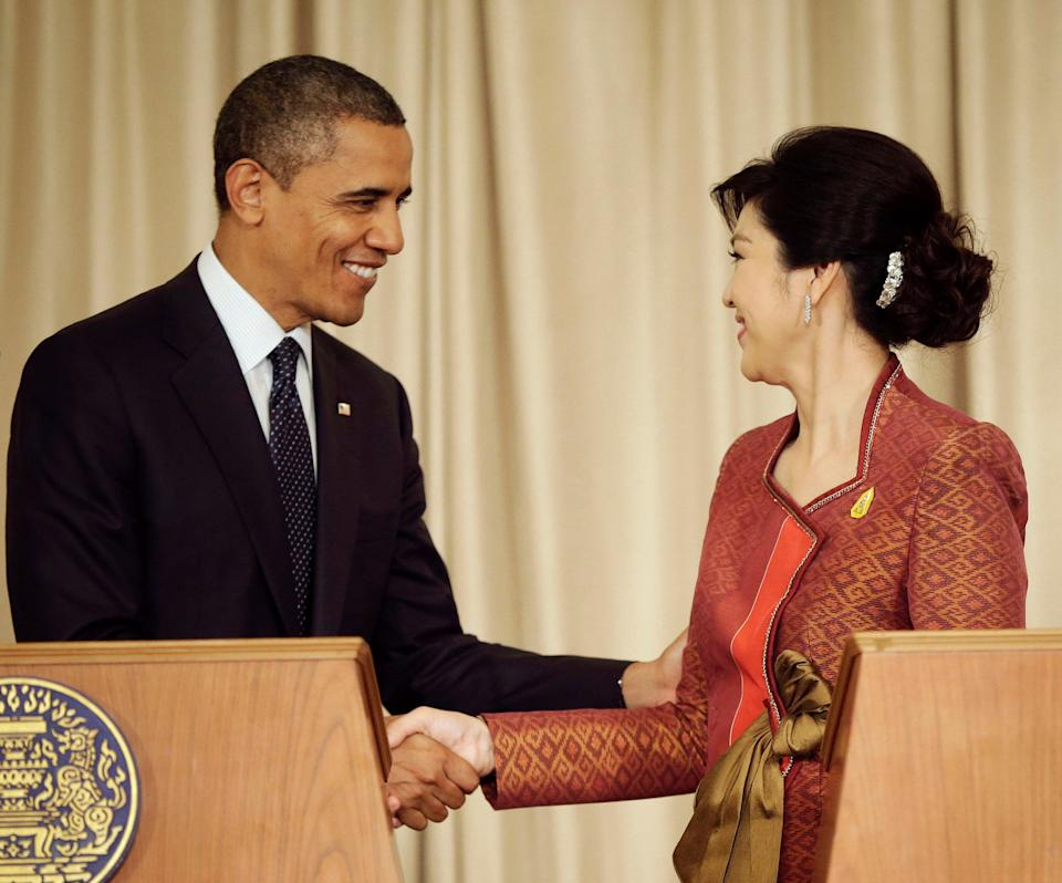 U.S. President Barack Obama, left, and Thai Prime Minister Yingluck Shinawatra shake hands following the conclusion of their joint news conference at Thai Government House in Bangkok, Thailand, Sunday, Nov. 18, 2012.